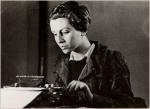 Gerda Taro at a typewriter, Paris 1936 -by Fred Stein